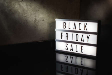 Black Friday Sale message on a light box with a dark cinematic feel