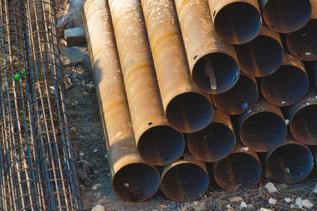 Industrial construction material - pipes stacked in a pyramid