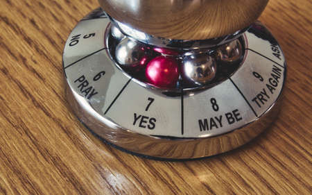 Metal decision maker with 'Yes' selected from the wheel of options