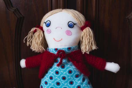 Closeup of knitted stuffed rag doll soft toy for a child
