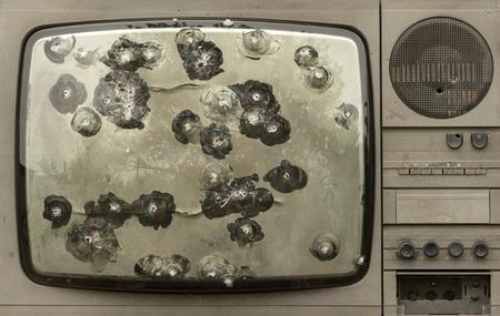 retro tv: Broken shot bullets television set