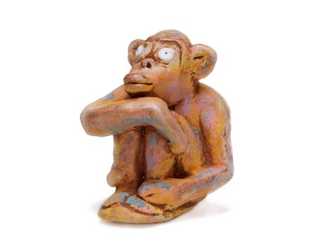 rueful: dreamy monkey  from clay pottery isolated on white