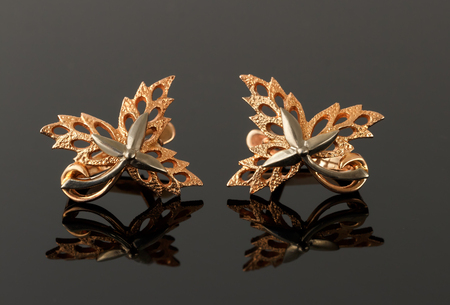 platinum: earrings in the form of maple leaves embellished with platinum