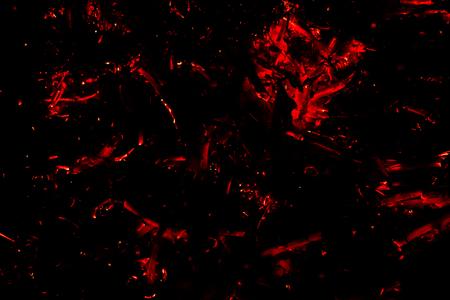 flying red hot sparks on a black background