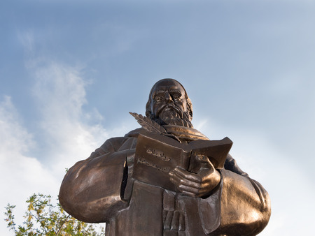 First monument to Persian philosopher and poet Omar Khayyam Nishapuri in Russia. Astrakhan. Monument on sky background.