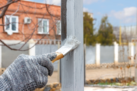 Hand painting on steel poles for construction and garden decorated. Half - painted surface. Smear of paint brush