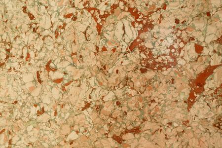 Abstrakter Marmoreffekt auf Wasser, genannt ebru. Gemischte rote, gelbe und grüne Farbe. Ungewöhnlicher Hintergrund für Plakat, Buch, Karte, Einladung, Beschaffenheit.