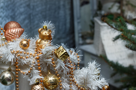 Christmas golden balls and toys and white garland decorations Standard-Bild