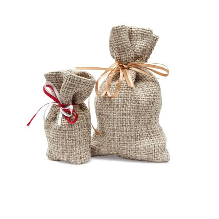 closeup two handmade linen bags with rough texture isolated on white Banque d'images