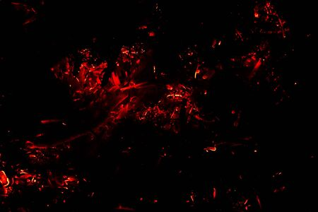 flying red  hot  sparks on a black background/the concept of risk of fires