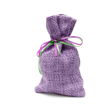 close-up big purple handmade sack of linen rough texture isolated on white