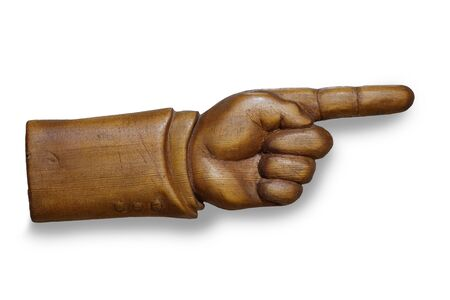 human hand indicates the direction, handmade, carved out of wood Imagens
