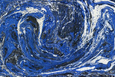 Creative abstract art background in blue, white and black colors. Handmade painted background. Acrylic painting on water. Liquid paint. Imagens