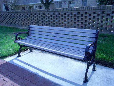main street: wooden bench on sidewalk along Main Street