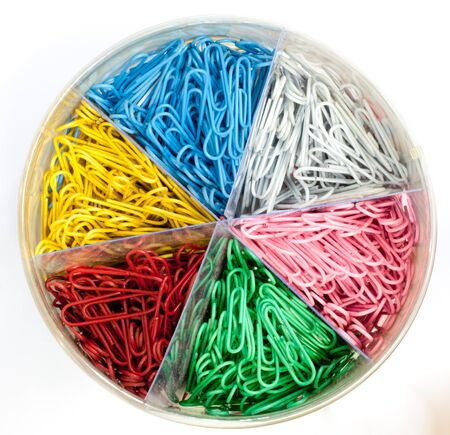 Box of colorful paper clip  in isolate white background Stock Photo