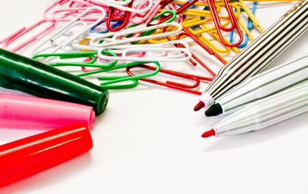 Colorful paper clip and magic pen in isolate white background