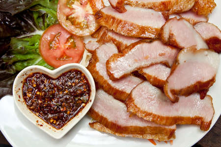 Ham steak serve with saland and thai traditional source