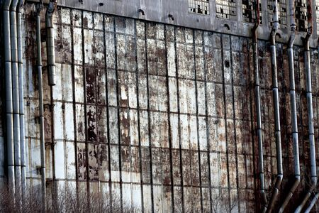 old photo: Photo of the very old wall of the abandoned factory Stock Photo