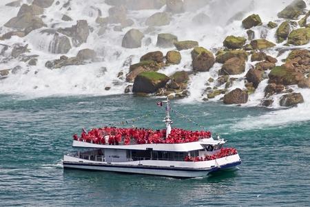 Beautiful photo of a ship near amazing Niagara waterfall