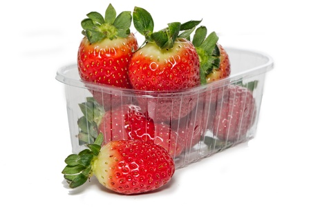Strawberries in plastic box on white background   photo