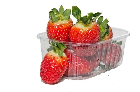 Strawberries in plastic box on white background   photo