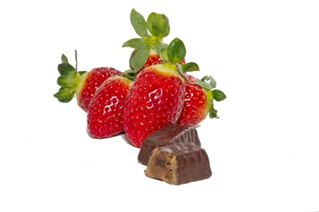 juicy strawberries and chocolate pralines on a white background Stock Photo - 13294977