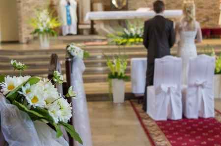 the wedding bouquete in church during ceremony photo