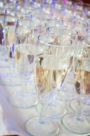 kots of full glasses  of champagne Stock Photo