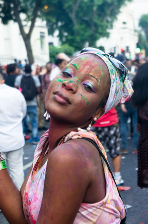 processions: LONDON - AUGUST 25: Participants of Notting Hill Carnival August 25, 2013 in London, UK. Europes biggest celebration of music, movement and masquerade.
