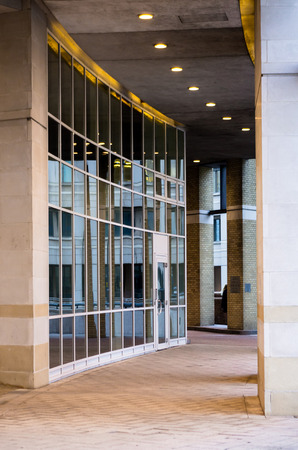Arcade with a glass wall - part of modern building photo