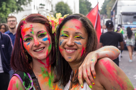 notting hill: LONDON - AUGUST 24: Performers take part in the First day of Notting Hill Carnival, August 24, 2014 in London, UK.