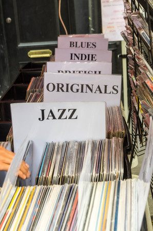 record shop: lots of vinyl records, divided into categories
