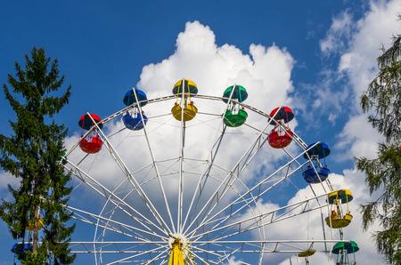 Ferris wheel with colored gondolas, amusement park photo