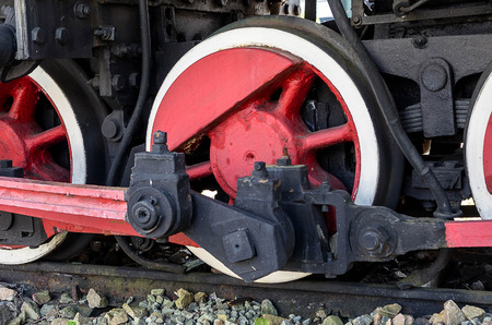 The drive wheels of an old steam locomotive photo