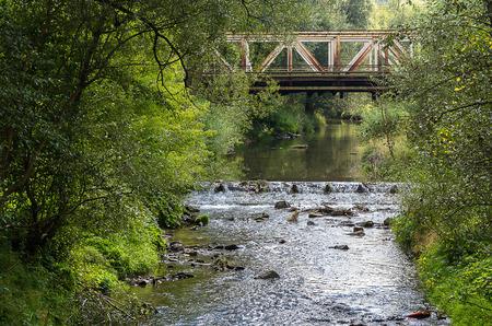viaduct: Old iron bridge over the river Stock Photo