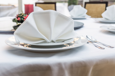 Empty served restaurant table with white tablecloth Stock Photo - 37927935