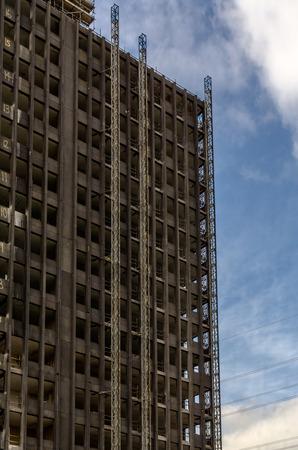 dismantle: Ruined skyscraper during demolition work