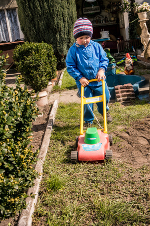 yard work: A little boy doing spring yard work Stock Photo