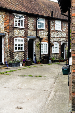 next to each other: Country lane with houses next to each other Stock Photo