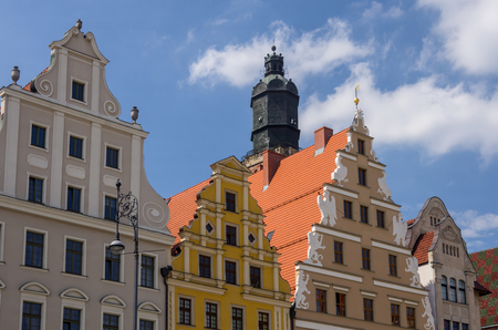 pl: WROCLAW,PL 23 JUNE - townhouses on the background of church Wroclaw,Poland - 23 June 2015