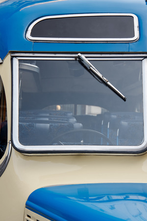 omnibus: the fron window with wiper, poart of old coache