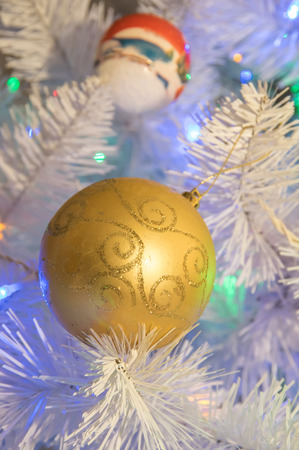 xmass: a golden xmass ball hanging at xmass tree Stock Photo