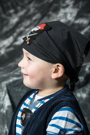 Young caucasian boy posing as pirat