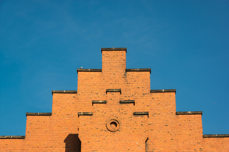 Nice brickwork at stepped roof. and cleared sky Stock Photo