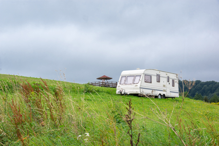 A campig trailer at grassef hil Stock Photo
