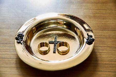 A pair of golde weding rings. su,bol of love