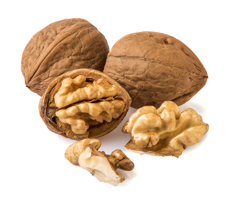 nuts and walnut kernels on a white background Imagens