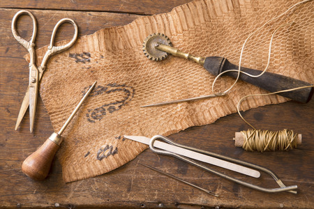 Leather craft tools on a wooden background Reklamní fotografie - 34172101