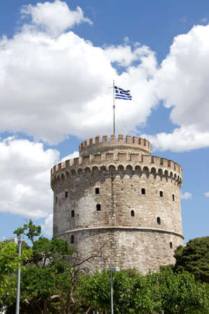 thessaloniki: White tower in Thessaloniki with the Greek flag Editorial