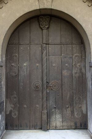 manacle: Old wooden massive door with shackles Stock Photo